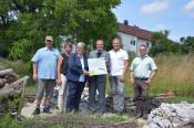 Freuen sich über die neuen Eidechsenhabitate (v. l.): Matthias Kaiser, Michaela Sattler, Gudula Nieke-Mast, Oberbürgermeister Klaus Eberhardt, Christoph Schmidt und Patrick Pauli.