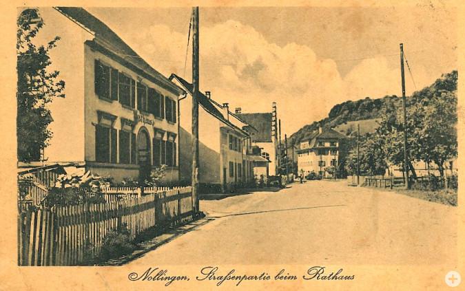 Straßenpartie beim Rathaus von Nollingen (1900)